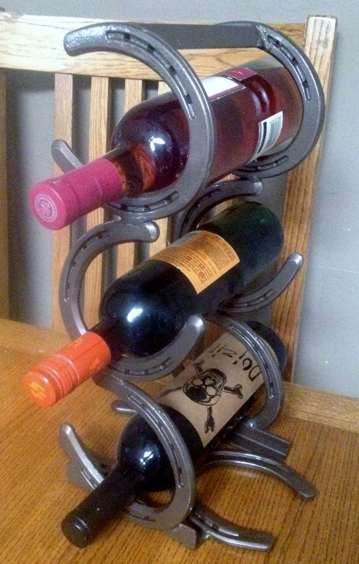 3 bottle horseshoe wine rack, custom made from forged steel. Message me for ordering information! #horseshoe #wine #winerack #forgedsteel #homedecor #western #cowboy #cowgirl #rustic #kitchen #country