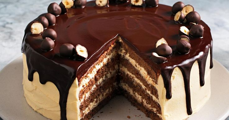 Frangelico-spiked dark chocolate crowns this hazelnut cake layered with Nutella and peanut butter frosting. You had me at Frangelico...