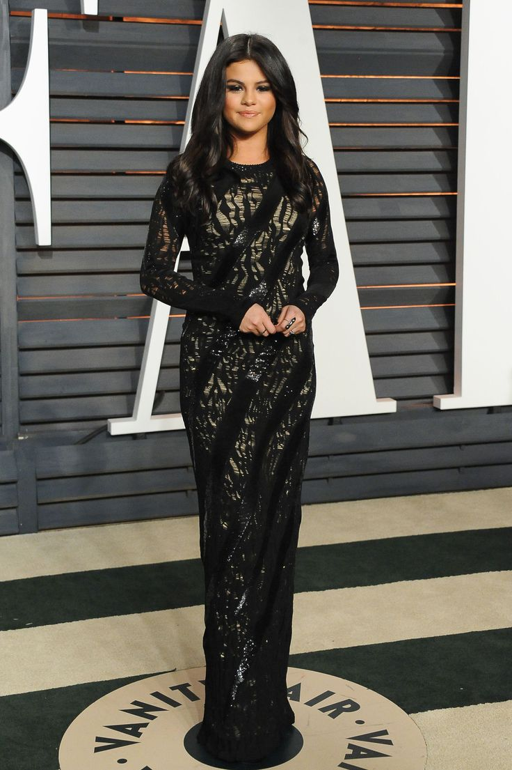 Wearing Louis Vuitton at the Vanity Fair Oscar Party.