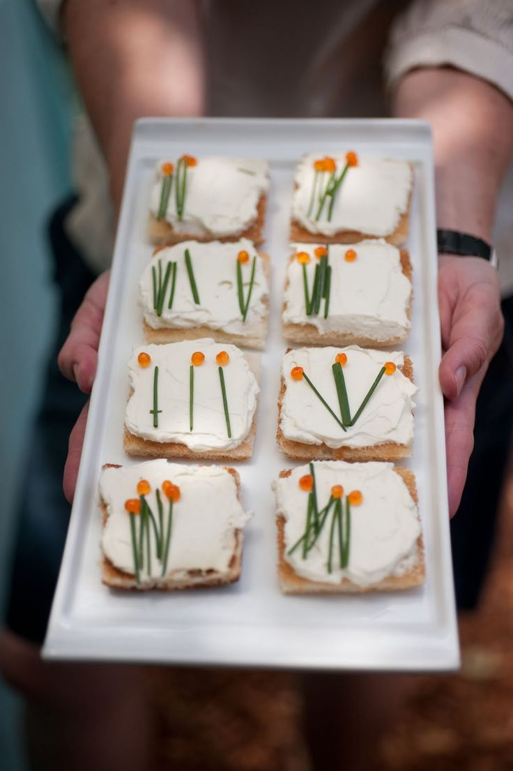 baby shower food. toasts w/ herbed cream cheese and chive/roe flowers.  so pretty!  but i'd use finely dices orange, red and yellow bell peppers in place of the roe.