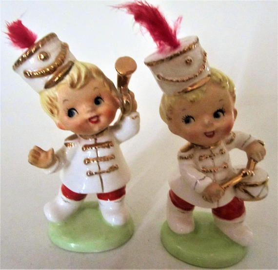 a Vintage 1960s pair of Boys playing drums and horn as a marching band figurine measuring 5 tall. a red feather cap. great idea for a cake topper! a hand painted figurine trimmed in Gold, nicely detailed. measures 4 1/2 ins. high. as found with no chips or cracks. a light cleaning needed. <><> Quite Unique, You wont Find a Cutie like this! <><>    are you a collector of Salt & Pepper Sets? check out these lovelies- http://www.etsy.com/shop/...