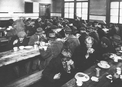 This picture shows many unemployed people sitting in a soup kitchen eating, during the Great Depression. It's credible because it was taken at the time, and the website it's on is real and accurate. You really see through this photo just a small part of how bad the lives of Canadians were at the time.