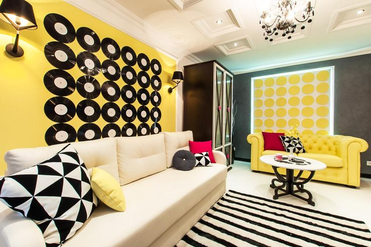 stunning pop art style interior idea with cicrle pattern wallpaper as well striped rug including yellow beige leather sofa
