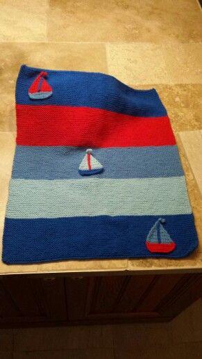Handknitted baby boy pram blanket