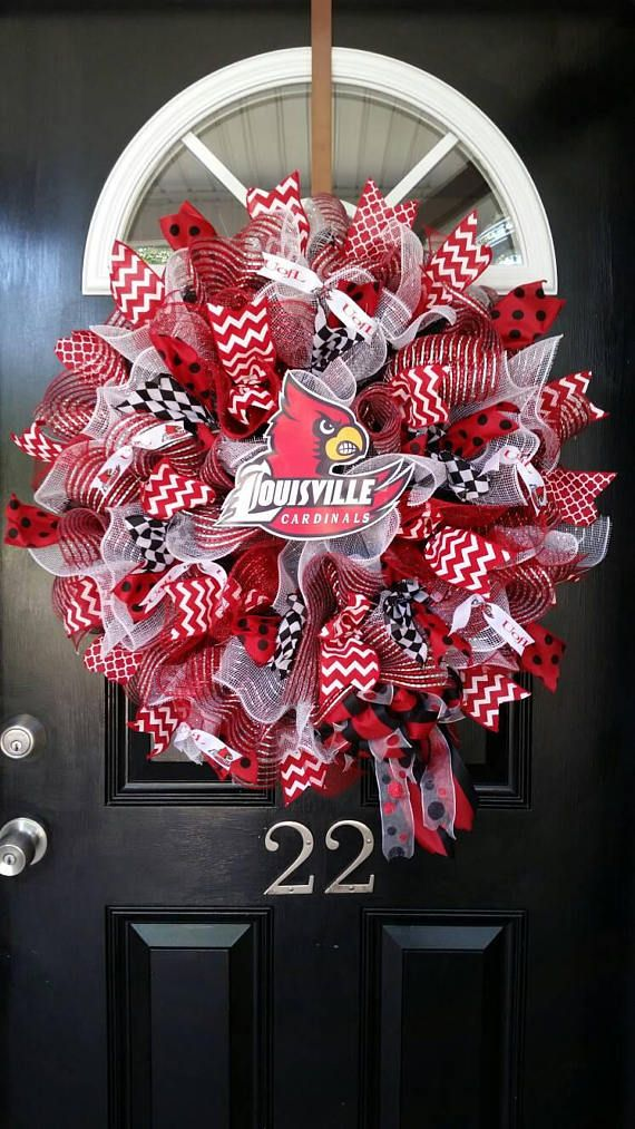 Louisville Cardinals! This large wreath will make a great statement on your front door! This wreath measures 24-26 in diameter and is filled with mesh and ribbons. The colors are bright and beautiful! Logo and ribbons according to availability. I CAN CREATE A WREATH WITH ANY TEAM