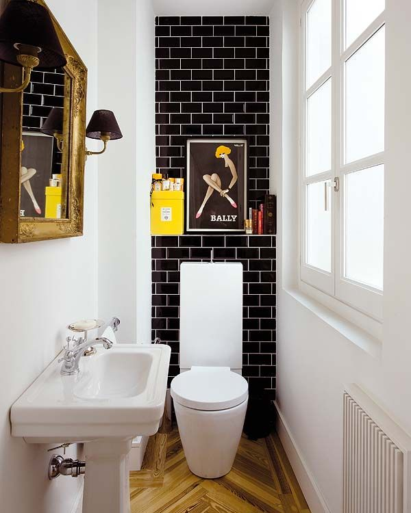 Black subway tile in a stylish small bathroom