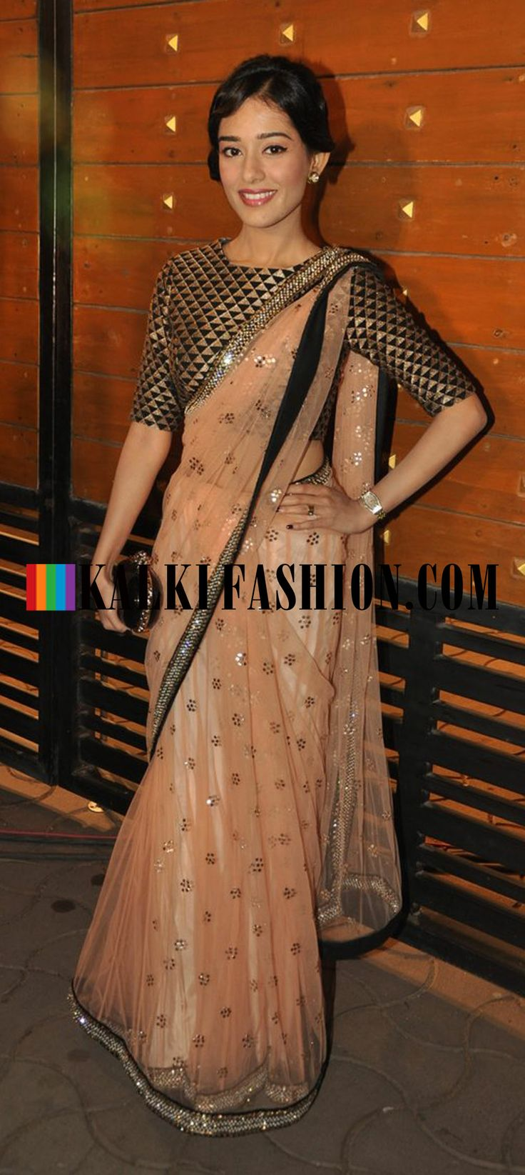http://www.kalkifashion.com/ Amrita Rao was seen in a beige saree by Payal Singhal at Filmfare Awards 2014