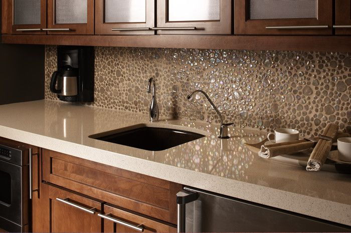 Light quartz countertops with dark honey maple cabinets Backsplash ideas quartz countertops