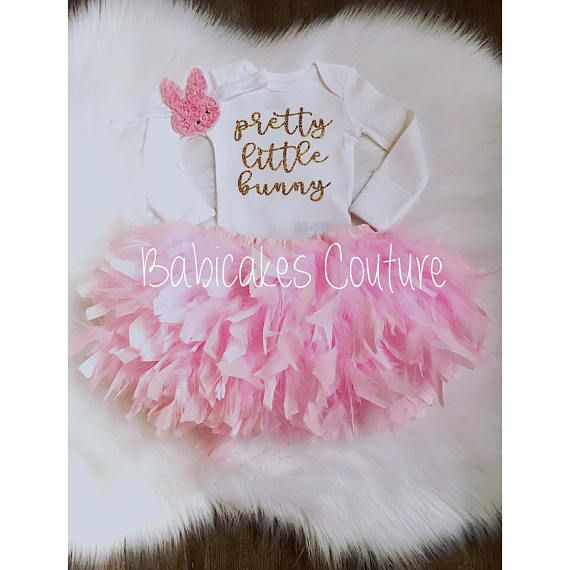 Pretty Little Bunny, Exclusively Babicakes Couture. The 3-Piece 1st Easter Outift Set includes: {Bodysuit} White bodysuit features sparkly no shed gold glitter Pretty Little Bunny. {Bloomer} Choice of 1/2 Feather (back side) or Full Feather (front and back) Feather Diaper Cover