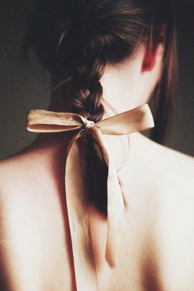 Tie a ribbon at the end of a braid. adds something playful and elegant without going over the top. Use with a single braid like this one, or braid just the upper half of your hair, and tie the ribbon at mid-length. :)