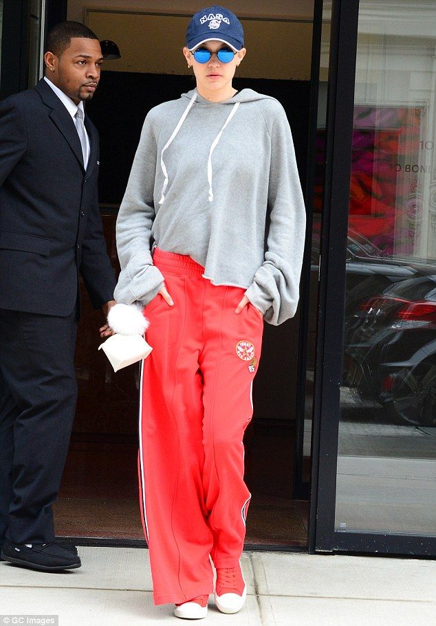 Low key: On Wednesday, Gigi Hadid stepped out in New York City while covered up in loose red track bottoms and an oversized grey hoodie