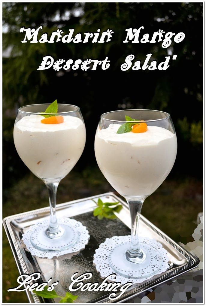 """Lea's Cooking: """"Mandarin Mango Dessert Salad""""  Mango flavored jello is stirred into whipped topping and then folded into a bowl of cottage cheese, popping bobas and mandarin oranges. It's a light and fluffy salad that is simple and easy to make."""