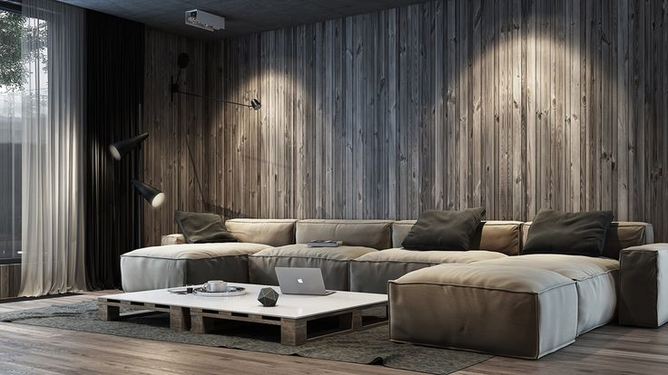 This wall treatment makes great use of vertical alignment and color variation to create a rustic pinstripe effect, providing visual interest in the absence of any tall furniture or wall hangings. Dramatic lighting and subdued neutral colors give this unique living room a mysterious yet relaxing atmosphere.