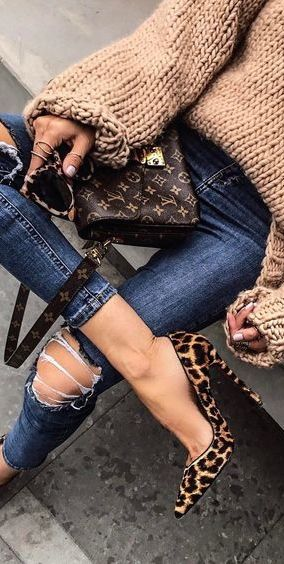 Everything. Sweater, pumps, Louis Vuitton, sunglasses, ripped jeans