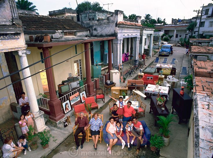 The Costa Family outside their home with all of their possessions, Havana, Cuba. Published in the book Material World, pages 106-107. From P...