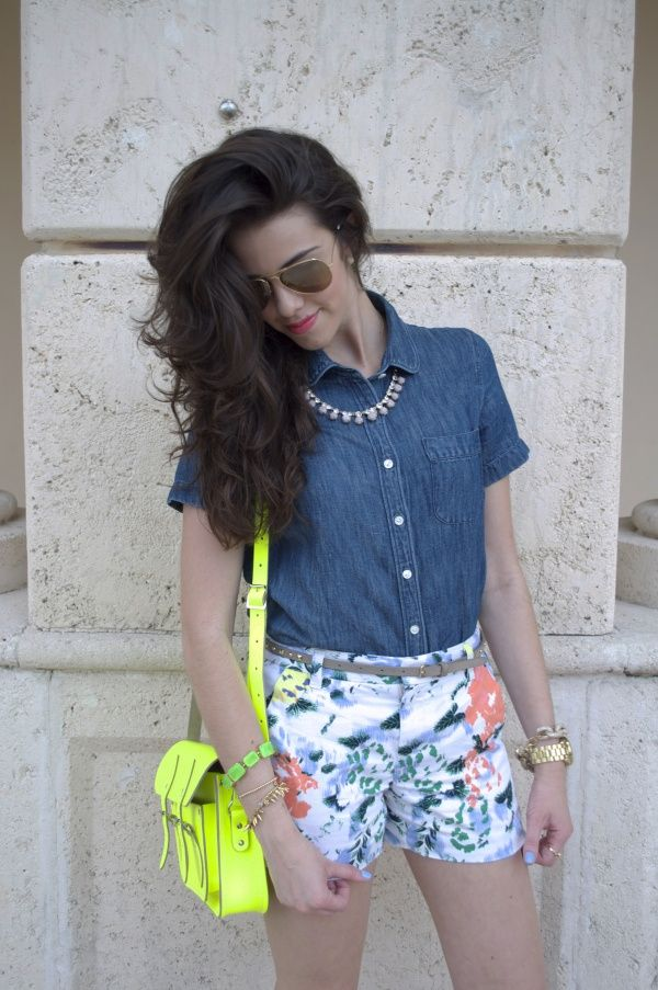 The Hottest Summer Trend: Floral Print! Add a neon bag, denim blue blouse, gold chain necklace  aviator sunglasses for a total look.