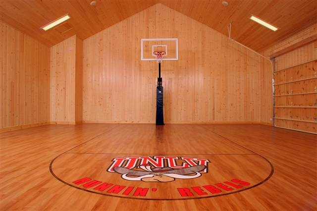 This basketball court doubles as a 3 car climate for Basketball hoop inside garage