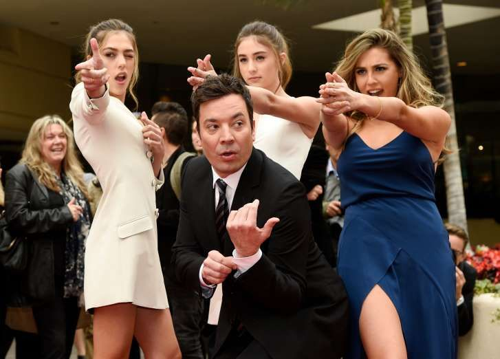 Best photos of 2017 - December 30, 2017:  Jimmy Fallon, host of the 74th Annual Golden Globe Awards, poses with Miss Golden Globes 2017, from left, sisters Sistine, Scarlet and Sophia Stallone after rolling out the red carpet during Golden Globe Awards Preview Day at the Beverly Hilton on Wednesday, Jan. 4, 2017, in Beverly Hills, Calif.
