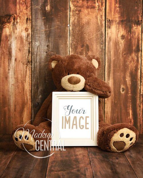 empty blank frame nursery stock styled photography giant stuffed animal teddy bear on wood background