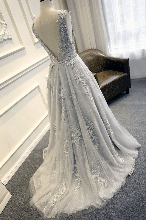 The Gray Blue Lace on this Wedding Dress gorgeous. Would be wonderful for a winter wonderland wedding