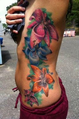 Orchid Tattoo Meaning   10 Most Stunning Flower Rib Tattoos for Girls   Rib Tattoos