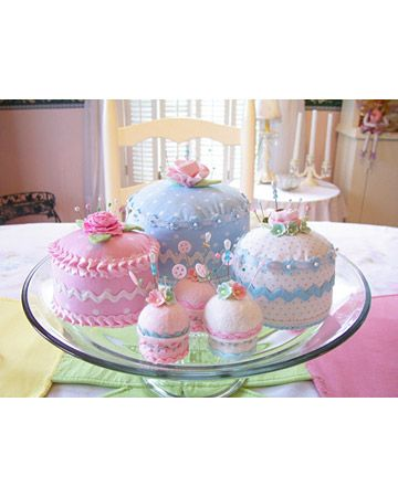 Cute decoration idea for a birthday party?? Cupcake pincushions could also be used in my craft room