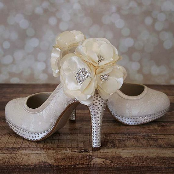 297.00 - out of price but i really like the flowers on the back.   Wedding Shoes  Ivory Lace Closed Toe by DesignYourPedestal on Etsy