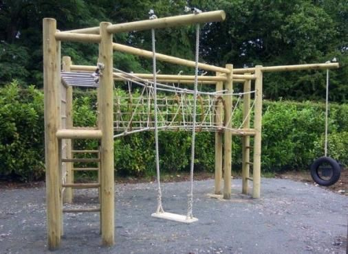Triple Tower Wooden Adventure Climbing Frame. Love the tire swing
