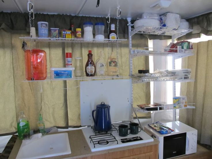 Organizing tips for pop ups *This is intense! We don't cook inside our camper but could definitely use shelves like this to keep toiletries, cooking supplies & games/entertainment. ~AM*