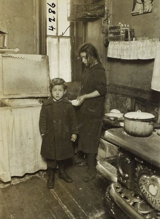 """Sister and Brother: """"New York: Tenement. Early 1900s."""" Photography by Jessie Tarbox Beals (1870-1942)"""