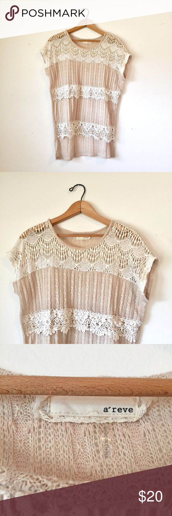 A'reve open knit crochet short sleeve top Beautiful A'reve open knit with crochet stripes high low light weight top. In excellent condition! Perfect top for work or the weekend. Pair with white pants or skinny jeans, statement earring and sandals or flats. A'Reve Tops Blouses