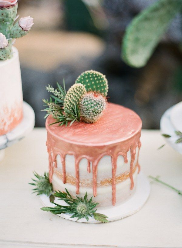 Now this is what you call trendy. This little beauty combines all of our favorite 2017 wedding trends, namely: metallics, drip cakes, semi-naked cakes, and cacti!