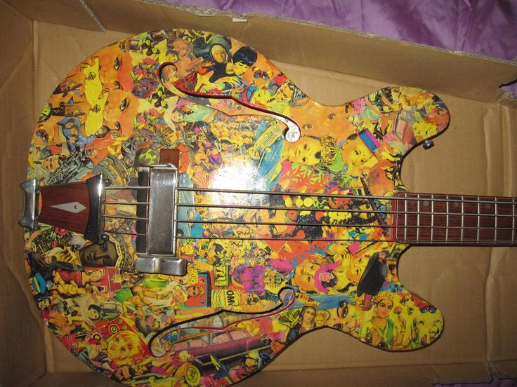 Univox U-1835 Hollowbody 1969. Covered in a paper collage for an advertising job. Underneath, the guitar itself was in pretty mint condition. The paper collage was peeling and yellowed so definitely not an attractive finish. This type of bass was the first I ever owned back in 1978.