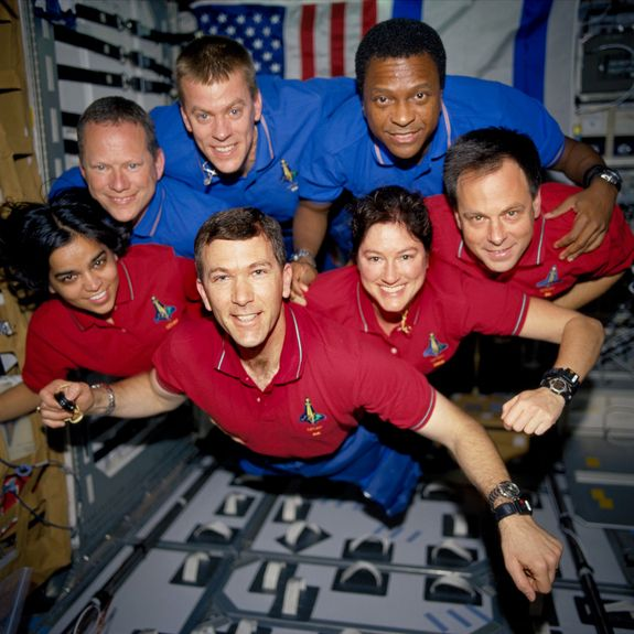 Remembering Columbia: On the bottom row (L to R) are astronauts Kalpana Chawla, MS; Rick D. Husband, mission commander; Laurel B. Clark ,MS; and Ilan Ramon, PS. In the top row (L to R) are astronauts David M. Brown, MS; William C. McCool, pilot; and Michael P. Anderson, PC. On February 1, 2003, during re-entry, Columbia disintegrated over northern Texas with all seven crewmembers aboard. This picture survived on a roll of unprocessed film recovered by searchers from the debris.