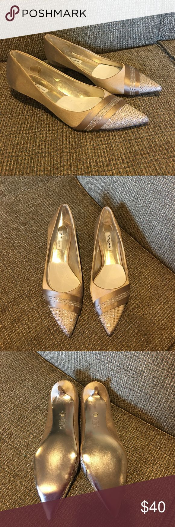 *sale* Nina New York Pointed-Toe Pump Nina New York Pointed-Toe Pump Brand New size. 10M. 1 1/2 inch heel, crystal satin Champagne color. Shoes are brand new and in mint condition but there is no box. Emmie style name. *sale* $25 firm Nina New York Shoes Heels