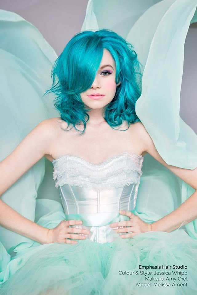What a beautiful image we have here, courtesy of Emphasis Hair Studio! Model Melissa Ament looks like a *Fairy Queen* in shades of turquoise and seafoam. The talented Senior Stylist Jessica Whipp used Manic Panic in Atomic Turquoise, Voodoo Blue, and Electric Lizard, and Amy Orel performed the gorgeous makeup artistry.