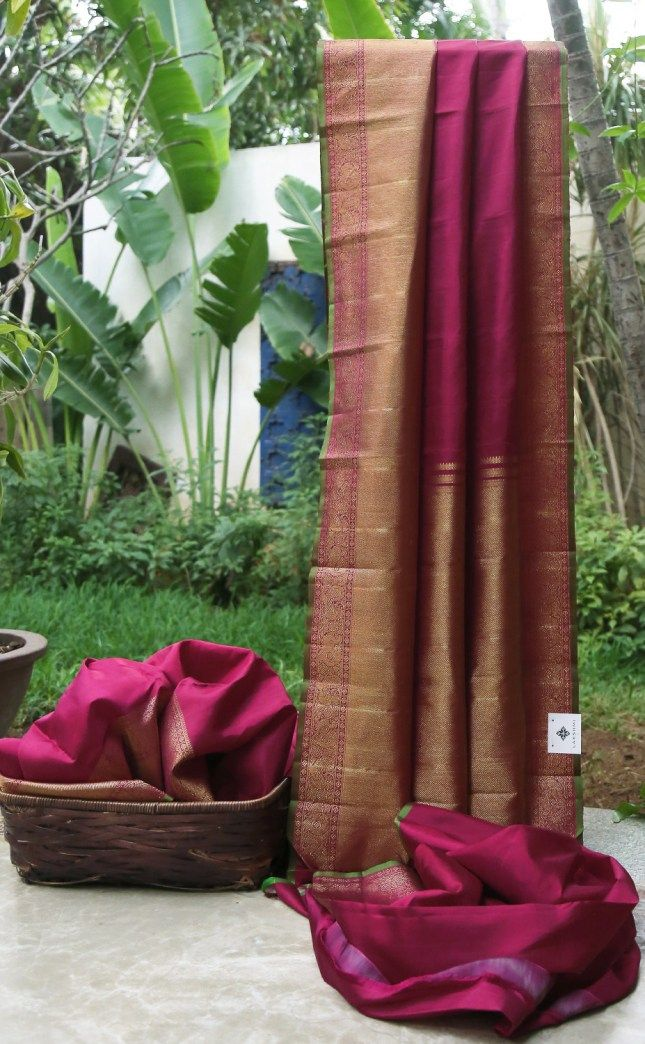 This simple yet elegant sari is a berry red kanchivaram silk. The border and pallu have an intricate weave of gold zari making it a must have for every Indian wardrobe