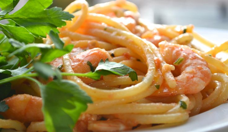 Top quality italian spaghetti with mazzancolle, tomato and parsley...