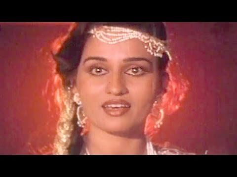 """Disco Station Disco - Reena Roy, Asha Bhosle, """"Let go, of my arms, of my path"""" Chorus: """"These are handcuffs of love!"""" """"The train is here, but he is not, look at me all dressed! My large doe eyes scan the junction, oh woe, my eyes met with who? Handcuffs of love are on you! People, do not rescue me, let me go thru the perils of love, hold me in your embrace, love me, but then it remember to let go!have to leave, handcuffed to him."""