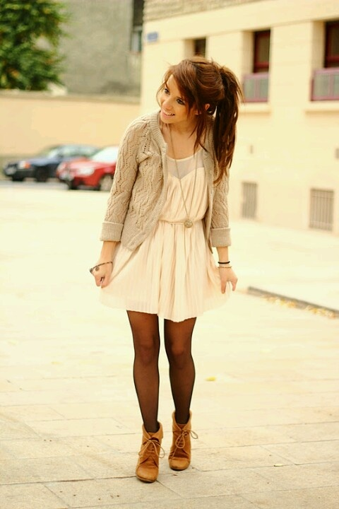 white dress, creme knit cardigan, black tights, lace up booties, necklace