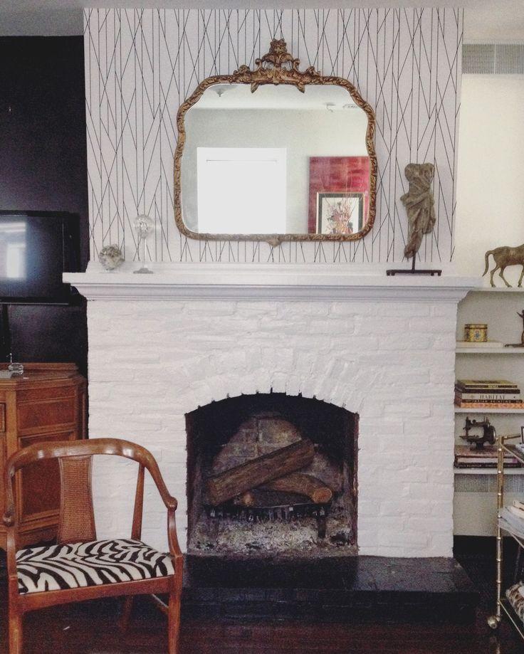 design manifest geometric wallpaper fireplace wall ornate mirror