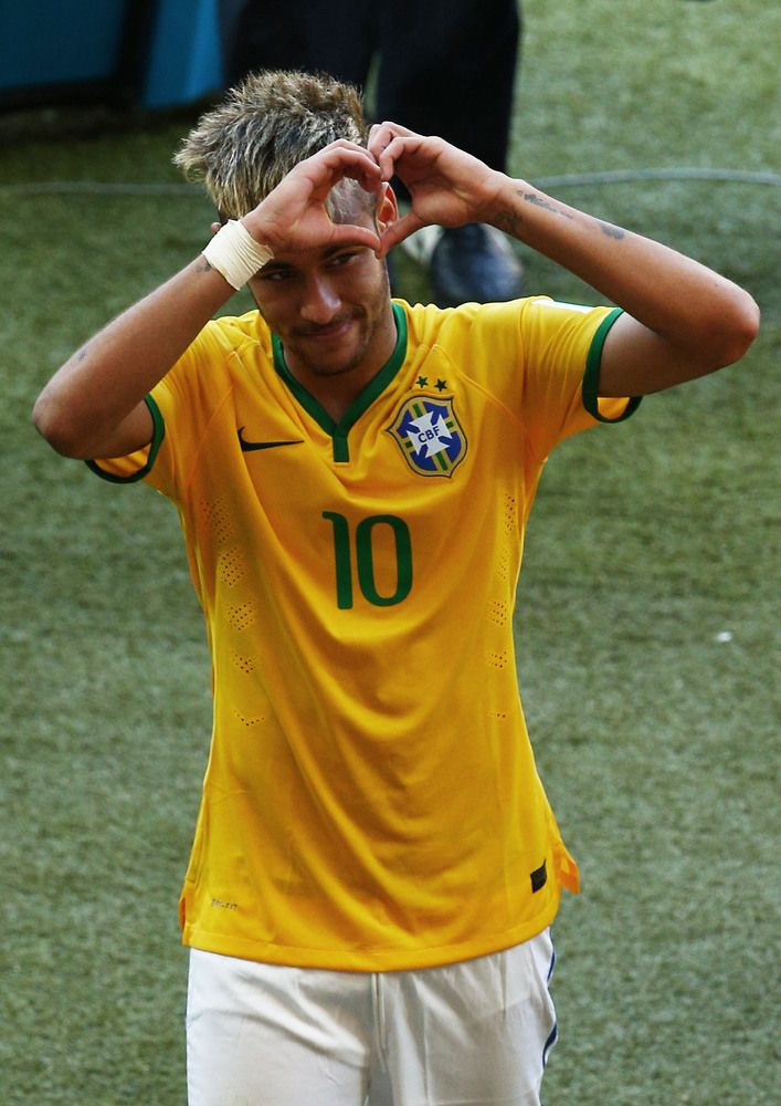 BELO HORIZONTE, BRAZIL - JUNE 28: Neymar of Brazil celebrates after defeating Chile in a penalty shootout during the 2014 FIFA World Cup Brazil round of 16 match between Brazil and Chile at Estadio Mineirao on June 28, 2014 in Belo Horizonte, Brazil. (Photo by Ian Walton/Getty Images)