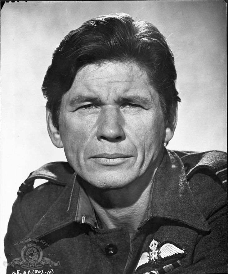 Charles Bronson in The Great Escape, a 1963 American film about an escape by Allied prisoners of war from a German POW camp during World War II. The film is based on the book of the same name by Paul Brickhill, a non-fiction account of the mass escape from Stalag Luft III in Sagan (now Żagań, Poland), in the province of Lower Silesia, Nazi Germany.