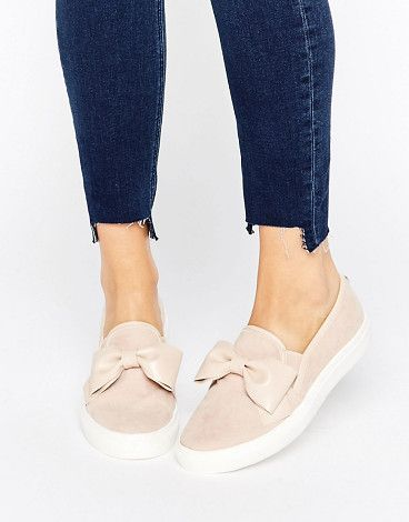 Bow Slip On Sneakers by Faith. Plimsolls by Faith, Suede style upper, Slip-on design, Faux-leather bow, Elasticated inserts, Shaped cuff, Textured tread, Wipe marks with a sot cloth, 80% Textile, 20% Polyurethane Upper.  #faith #sneakers #activewear #athleisure
