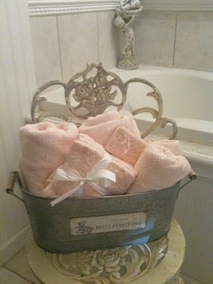 French Country Bath Bucket Filled With Pink Towels And A Pink Bar
