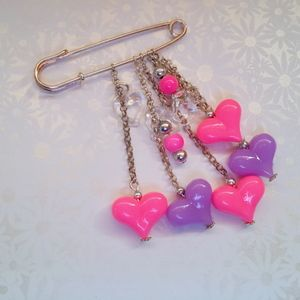 Gorgeous Handmade Neon Pink & Purple Hand Bag Charm or Scarf Pin.  Made by Lezelle at www.lillarosegifts.com. We are based in Cape Town, South Africa, but can ship worldwide.  Visit us on Facebook: www.facebook.com/LillaRoseGifts