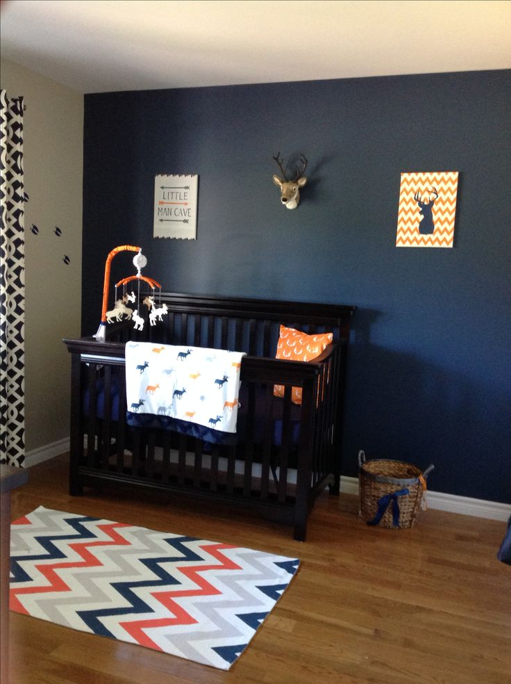 "I like the ""little man cave"" poster - and sports stuff instead of deer, and also an orange accent wall instead too lol"