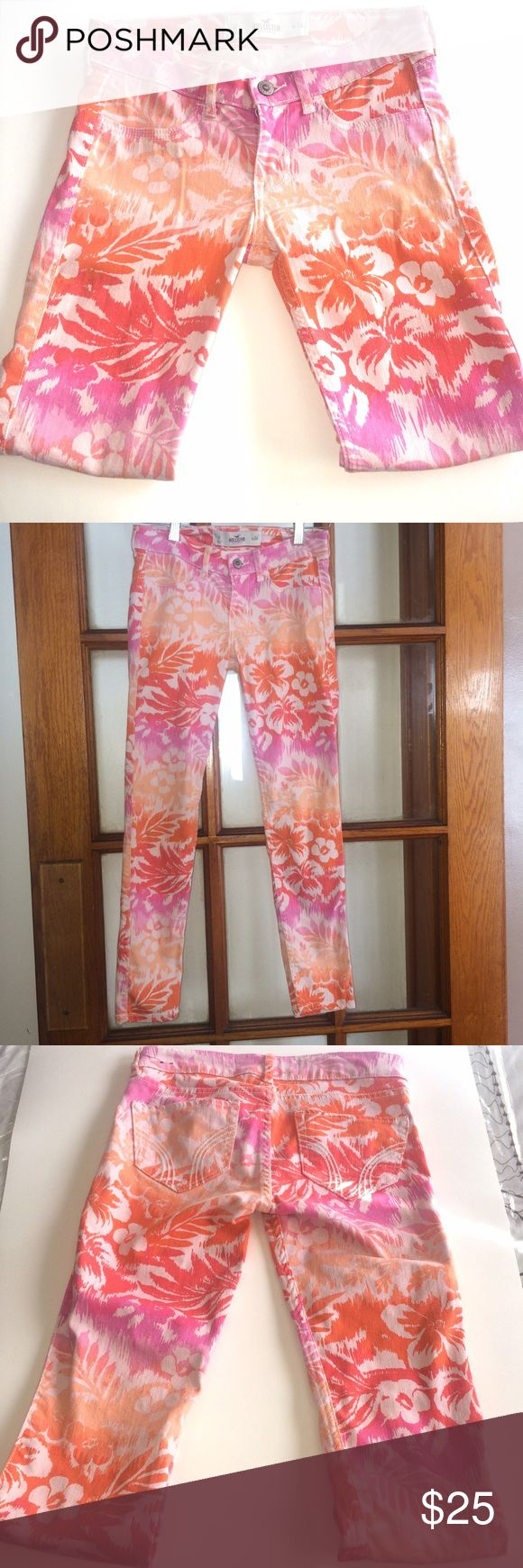 Hollister Floral Betty Skinny Jeans 👖 EUC Hollister Bettys Super Skinny Pink Floral Orange Ankle Jeans  Women's Size 0/ 24 inch waist.   Colorful all-over floral print, iconic back pocket stitching, Imported 98% cotton / 2% spandex Hollister Jeans Skinny