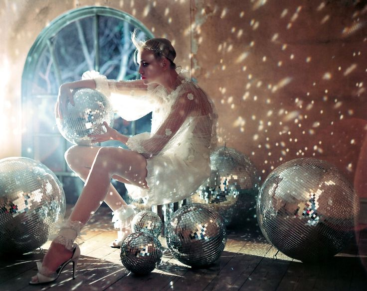 Tim Walker disco balls and reflections.