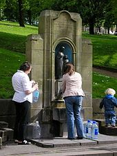 People filling up bottles with water at St. Ann's Well, Buxton, the same mineral water that gets bottled and sold everywhere